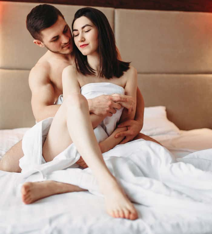 couple hugging in bed