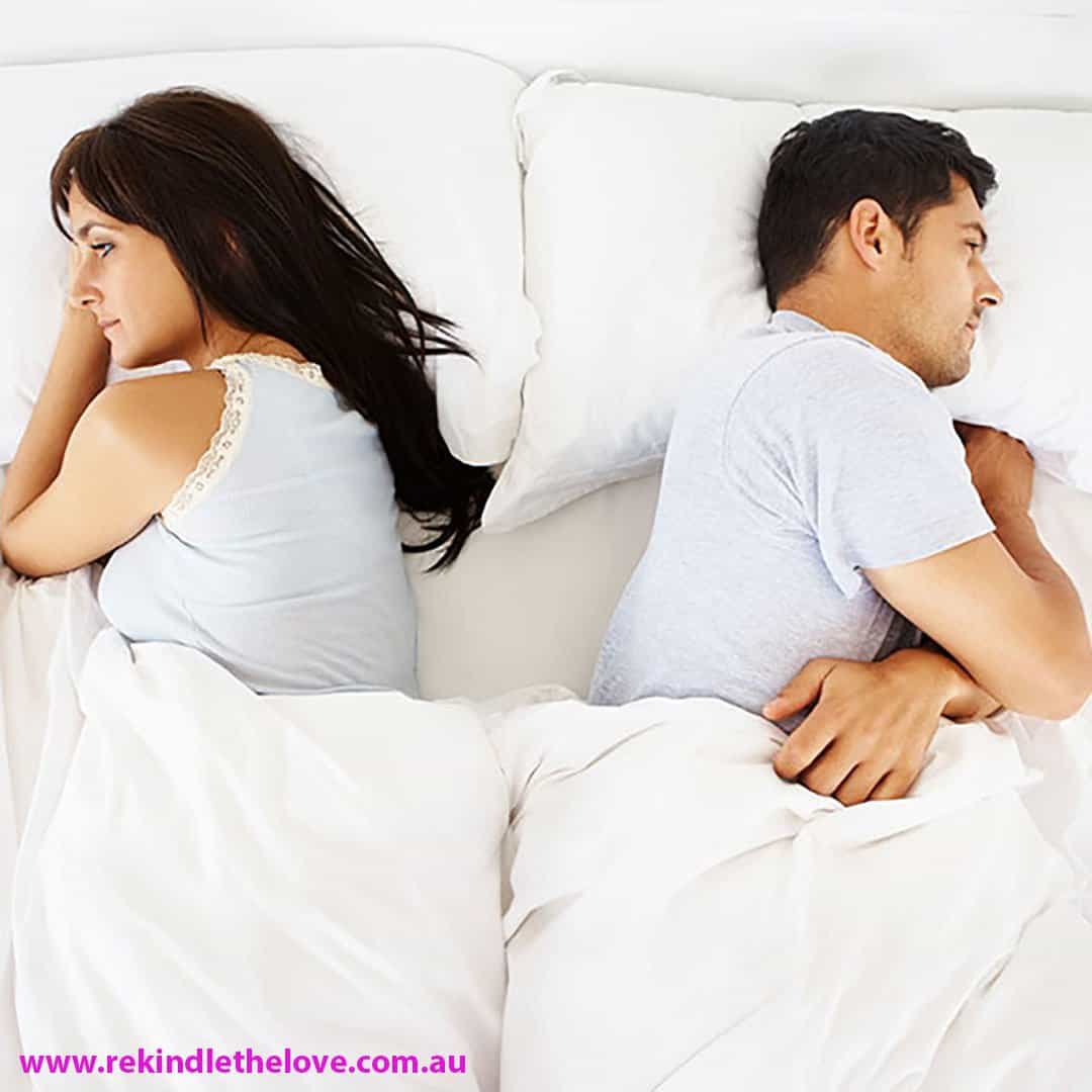 couple back to back in bed