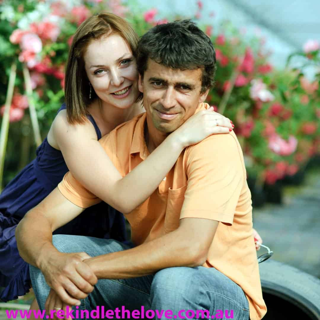 young happy couple posing for camera