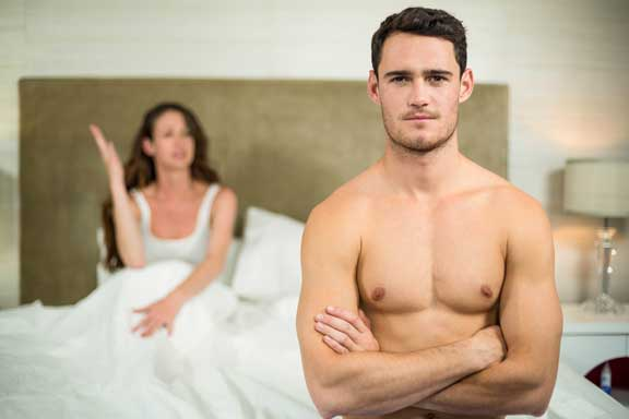 a couple arguing in the bedroom